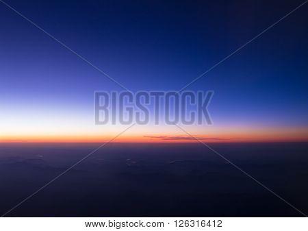 Beautiful Sunset Sunrise Dramatic Sky Over Dark Ground. View From Height Of Airplane