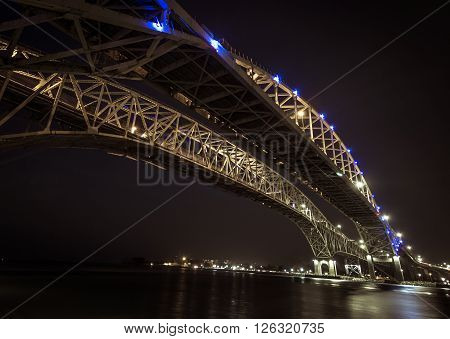 Blue Water Bridge. The twin spans of the Blue Water Bridges international border crossing between Port Huron, Michigan and Sarnia Ontario. This is the second busiest crossing between the US and Canada