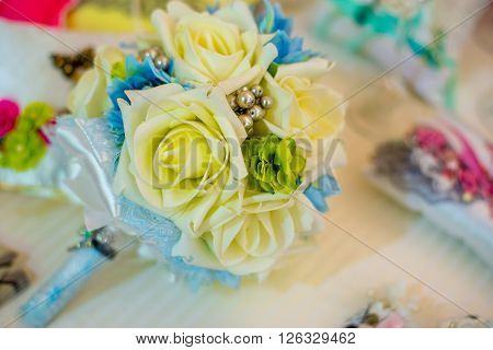 bridal bouquet of silk ribbons. yellow roses