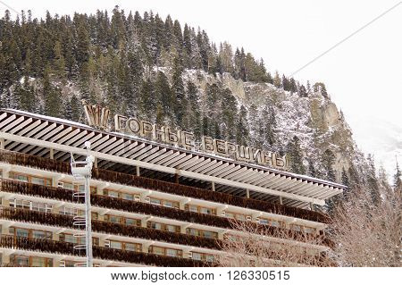 "Dombay, Russia - February 7, 2015: The Top Part Of The Facade Of The Hotel ""mountain Peaks&quot"