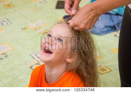 A Girl Of Four Years Old Sitting And Laughing Happily, When She Made Her Hair