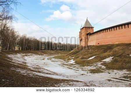 Veliky Novgorod, Russia - March 12, A wide moat in front of the Kremlin walls, March 12, 2016. Types of towers and walls of Kremlin in Veliky Novgorod.