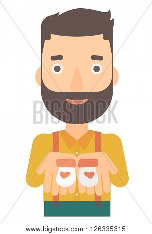 Man holding baby booties.
