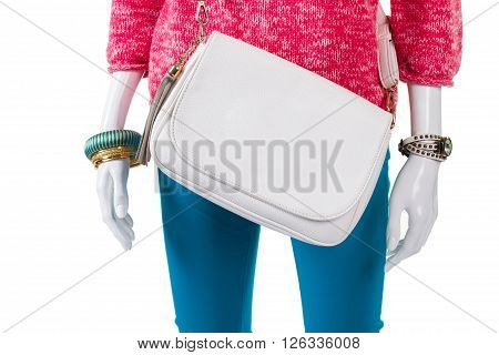 White bag and pink pullover. Plain leather purse on mannequin. Woman's brand new leather handbag. Discount for trendy accessories.