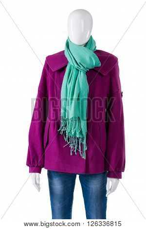Turquoise scarf and purple coat. Mannequin wearing coat with scarf. Lady's colorful autumn apparel. New clothes from outlet shop.