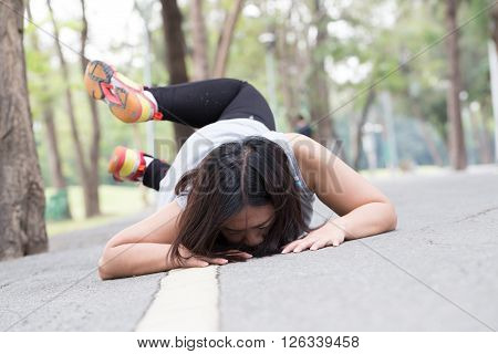 Accident. stumble and fall while jogging in the park