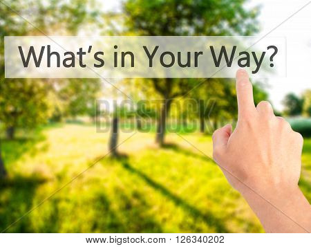 What's In Your Way? - Hand Pressing A Button On Blurred Background Concept On Visual Screen.