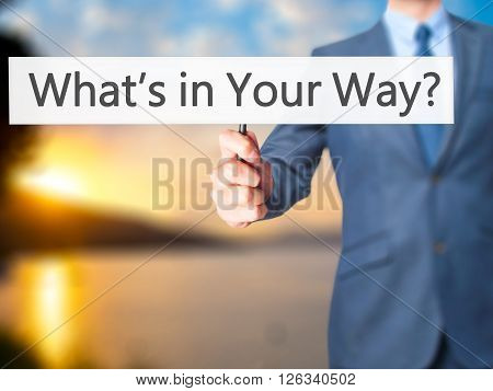 What's In Your Way? - Businessman Hand Holding Sign