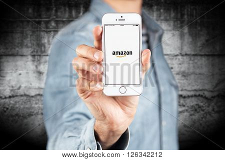 WROCLAW, POLAND - APRIL 12, 2016: Apple iPhone SE smartphone with Amazon app on screen