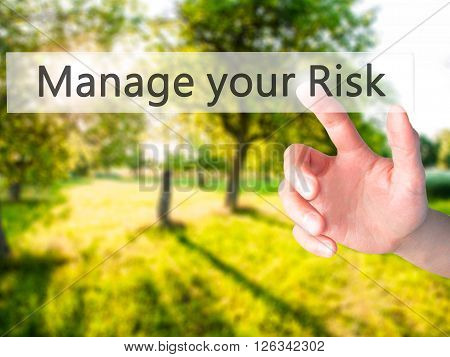 Manage Your Risk - Hand Pressing A Button On Blurred Background Concept On Visual Screen.