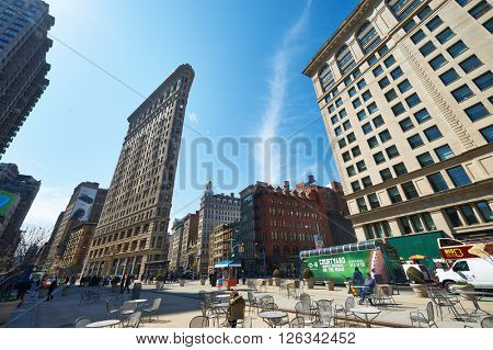 NEW YORK CITY - MARCH 27: Historic Flatiron Building at Manhattan street,  March 27 2014 in New York, USA