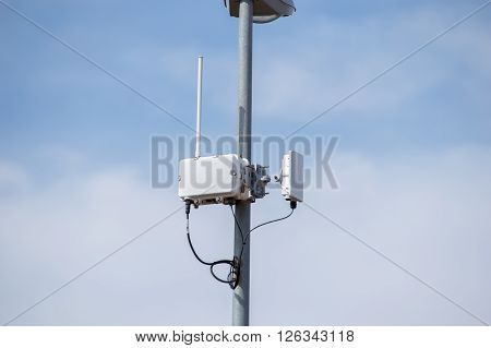Antennas of mobile cellular systems with wifi hot spot repeater and cloudy blue sky