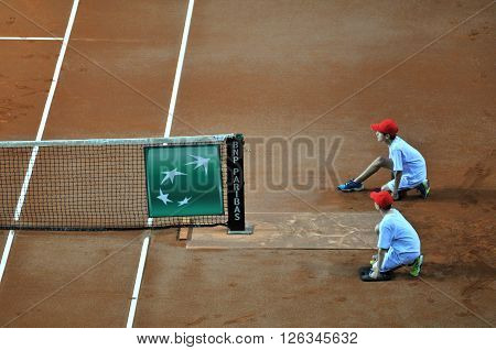 Ball Boy In Action During A Tennis Match