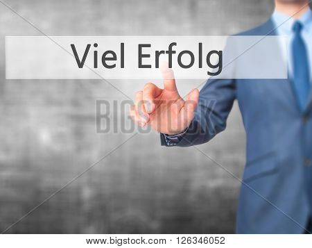 Viel Erfolg  (much Success In German) - Businessman Hand Pressing Button On Touch Screen Interface.