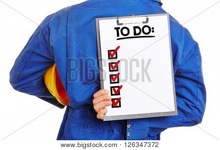Worker holding a To Do list on a clipboard behind his back