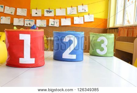 Red Green And Blue Jars With Written One Two And Three On The Table In The Kindergarten