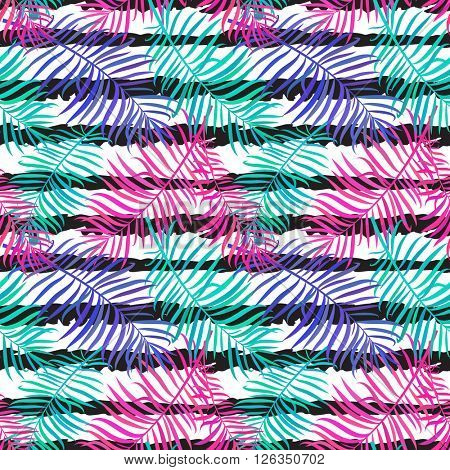 Summer seamless background with bright palm leaves on ink striped background. Tropical trendy seamless pattern with exotic palm leaves. Textile pattern.