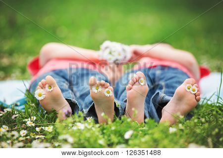 Happy Little Children, Lying In The Grass, Barefoot, Daisies Around Them