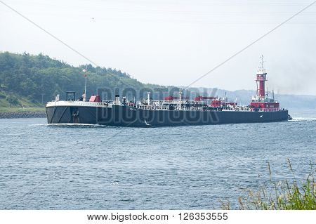 CAPE COD CANAL MASSACHUSETTS/USA - JULY 4 2006: Double-hulled oil barge passing through Cape Cod Canal