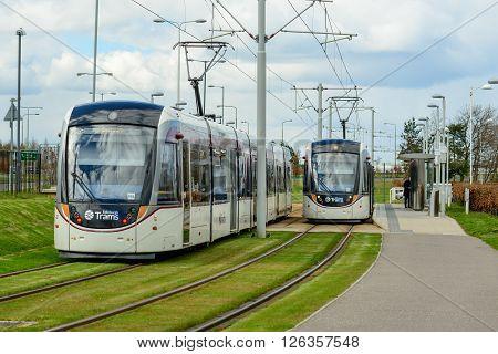 EDINBURGH SCOTLAND - APRIL 16 2016: Two Edinburgh tramcars at Gyle Centre station to the west of the city.