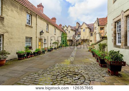 EDINBURGH SCOTLAND - APRIL 16 2016: A view of Whitehorse Close in the Cannogate on the Royal Mile in Edinburgh. Birthplace of William Dick founder of the Royal Dick Veterinary School.