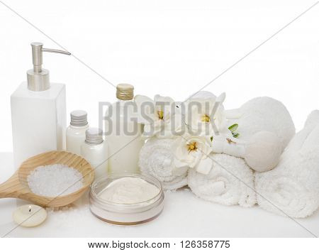 Spa setting with gardenia on towel