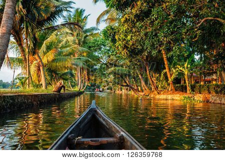 Kerala backwaters tourism travel in canoe boat. Kerala, India