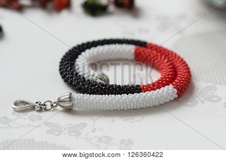 Beaded Necklace Of White, Red And Black Beads