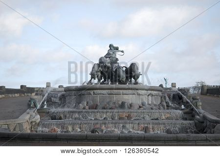 COPENHAGEN, DENMARK - NOVEMBER 03, 2014: View Gefion fountain, cloudy november evening. The landmark of Copenhagen, Denmark