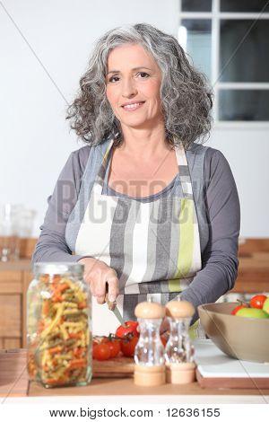 Portrait of a senior woman cooking