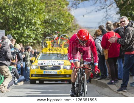 Conflans-Sainte-Honorine, France-March 6, 2016: The Russian cyclist Sergey Lagutin of Katusha Team riding during the prologue stage of Paris-Nice 2016.