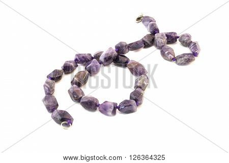 Necklace from amethyst on a white background