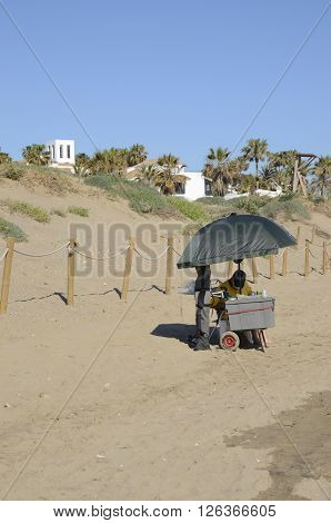MARBELLA, SPAIN - APRIL 9, 2016: Man selling accessories for fishing on the beach of Marbella Spain