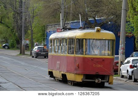 Old tram Tatra T3 on the street of Podol district in the historical center of Kiev. At April 19,2016 in Kiev, Ukraine