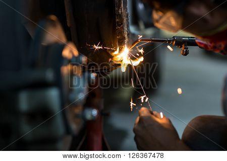 Auto body repair series : Welding in low key lighting