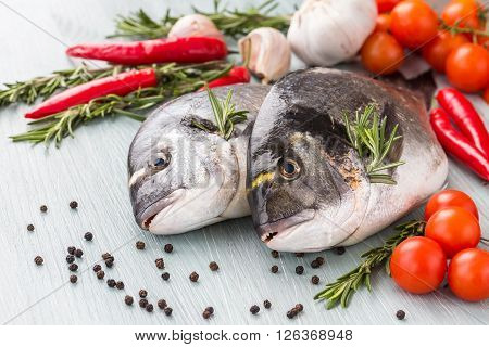 Raw Fresh Dorado Fish With Vegetables And Spices On The Table