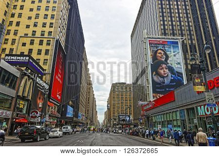 NEW YORK USA - MAY 6 2015: 7th Avenue in Midtown Manhattan New York USA. It is called Times Square. Tourists around