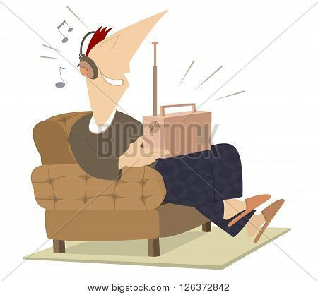 Listened the radio man. Smiling man sits in an armchair and listens the radio