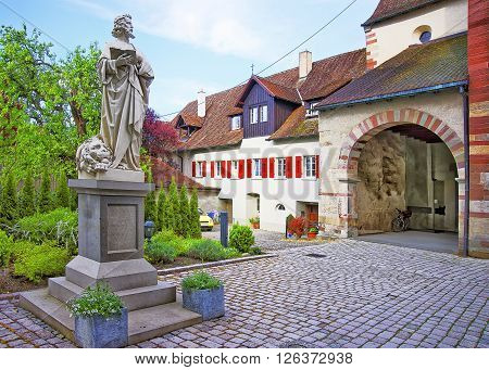 Entrance to Benedictine St Mary and Mark Abbey in Reichenau Island on Lake Constance. Reichenau is an island in Baden-Wurttemberg in Germany. It is under the UNESCO protection.