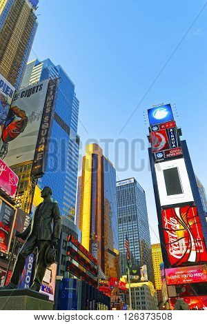 NEW YORK, USA - APRIL 26, 2015: Times Square at 7th Avenue and Broadway in Midtown Manhattan New York USA. It is called Times Square. Tourists around.