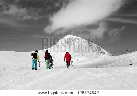 Three snowboarder on slope. Caucasus Mountains Georgia region Gudauri. Selective color.