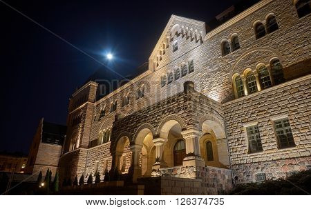 emperors castle and moon in night in Poznan Poland