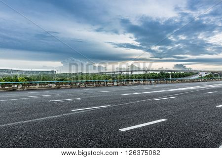 road near by the airport under the cloudy sky