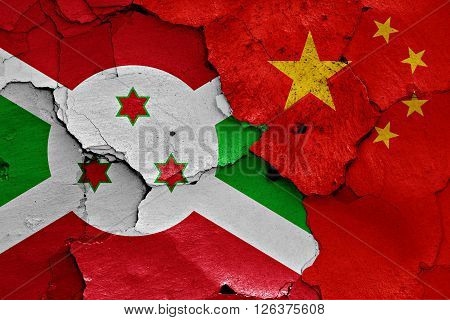flags of Burundi and China painted on cracked wall