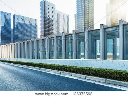 highway railings,highrise buildings