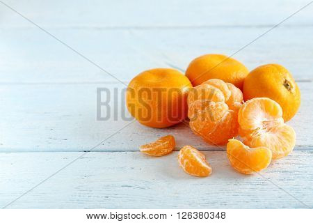 Ripe Mandarins On A Blue Wooden Table