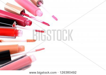 Colorful Lip Gloss On A White Background
