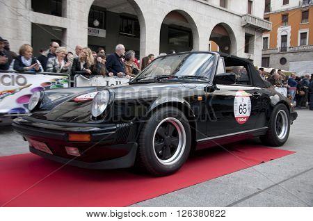 BRESCIA, ITALY - APRILE 17, 2016:500 Miglia. Finish. PORSCHE 911, 1984 built