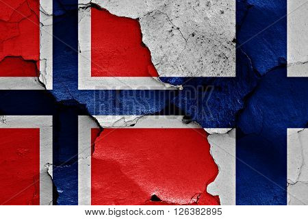 flags of Norway and Finland painted on cracked wall