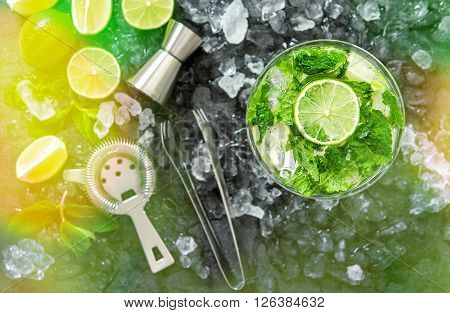 Mojito cocktail ingredients. Drink making accessories. Colorful party lights effect